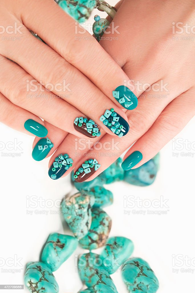 Manicure with beads and turquoise. stock photo
