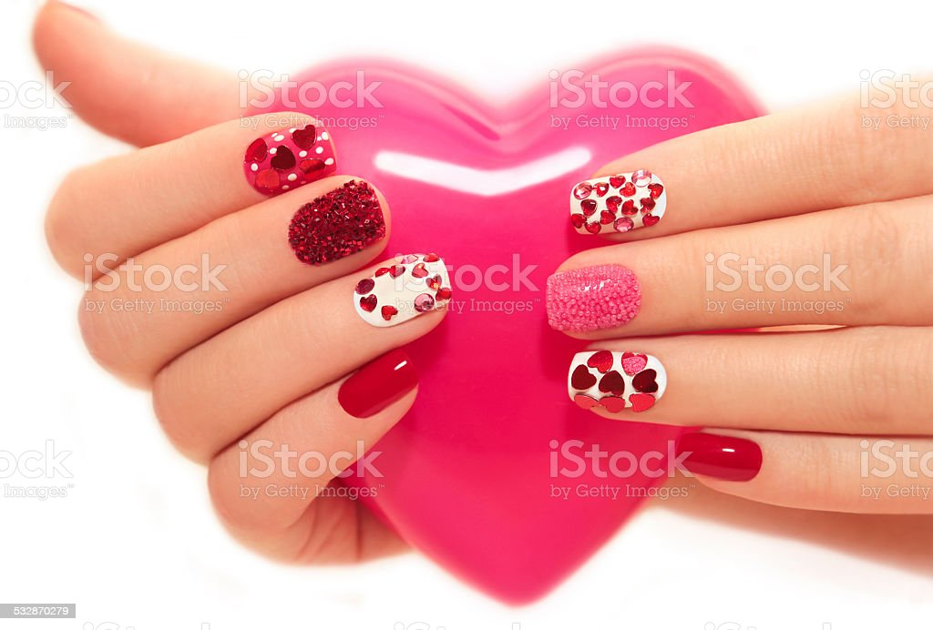 Manicure with hearts stock photo