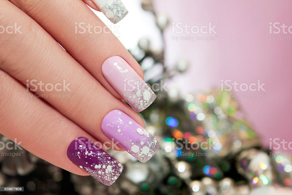 Manicure with snowflakes. stock photo