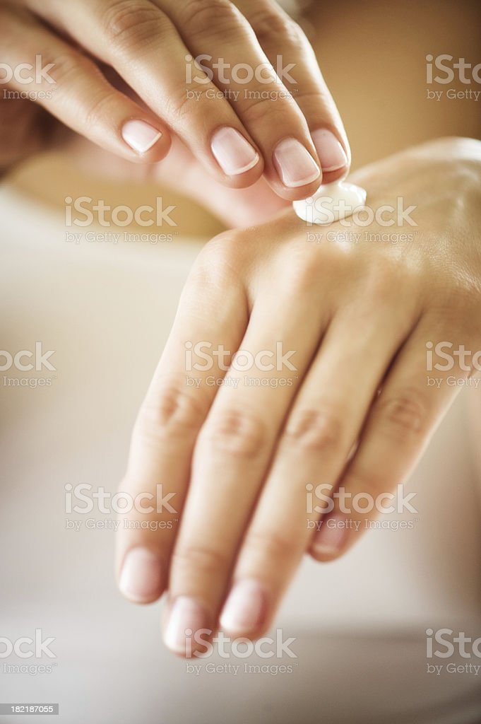 manicured hands with moisturizer stock photo
