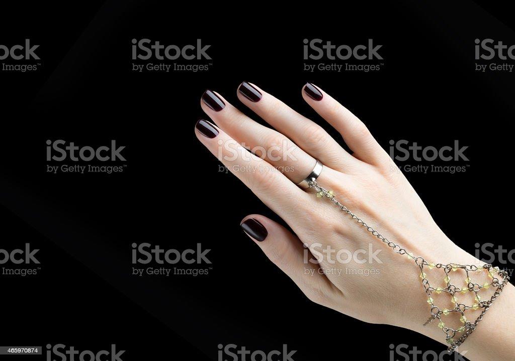 Manicured Nail with Black Matte Nail Polish. stock photo