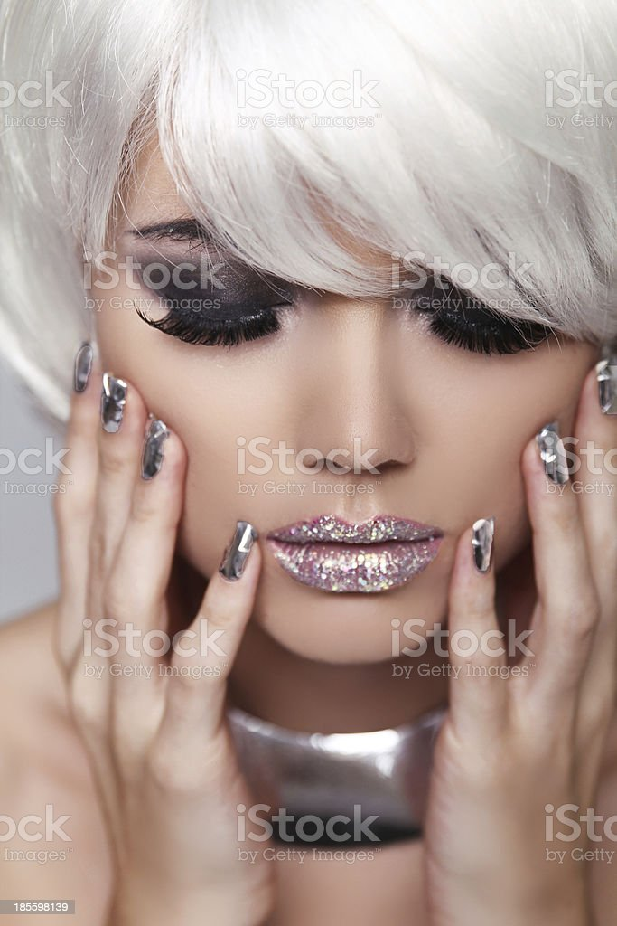 Manicured nails. Eye make up. Fashion Blond Girl. Beauty royalty-free stock photo