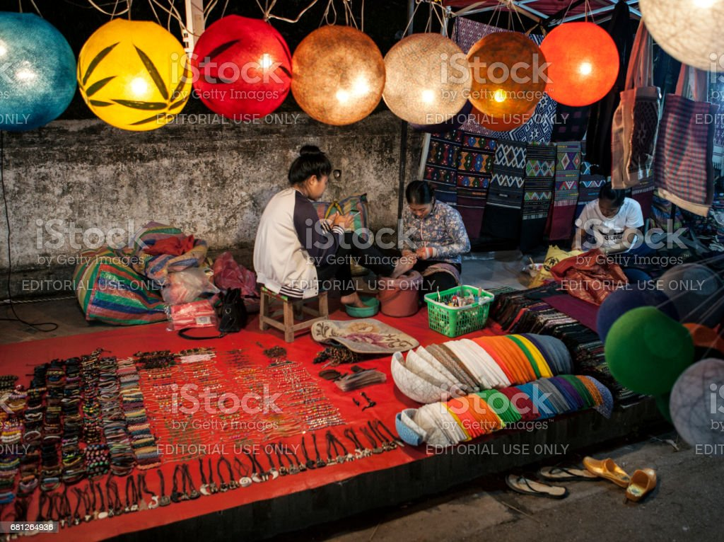 A Manicurist woman at the night Bazaar in Luang Prabang stock photo