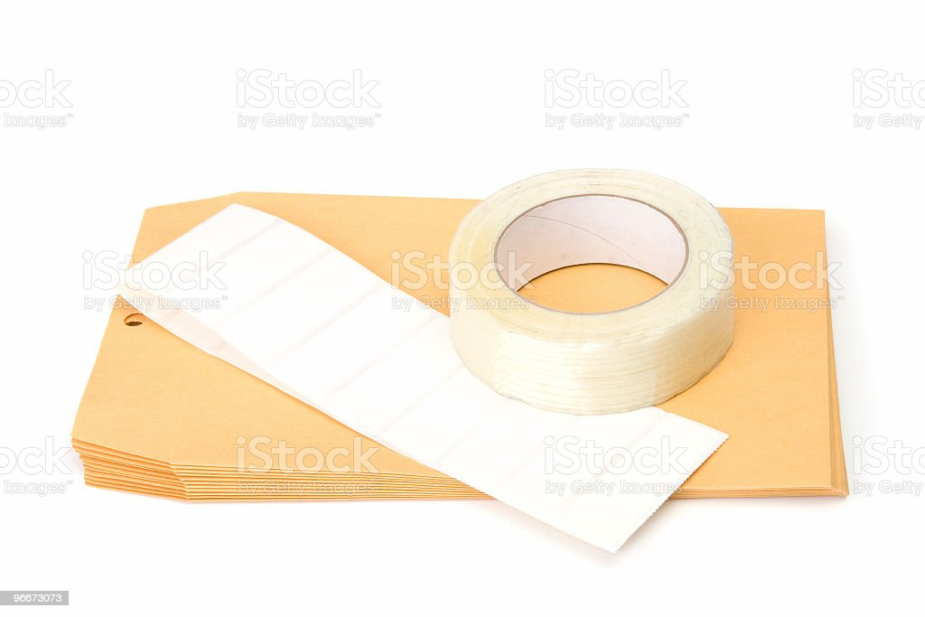 Manila envelopes, labels and packing tape royalty-free stock photo