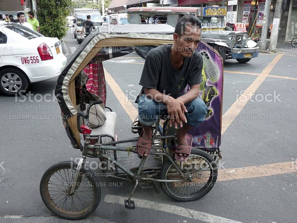 Manila pedicab driver, Philippines stock photo