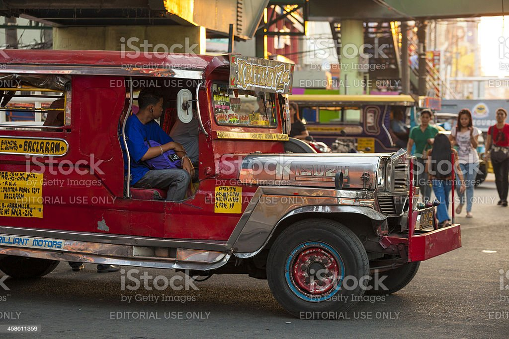 Manila, Philippines2: Red Jeepney in traffic stock photo