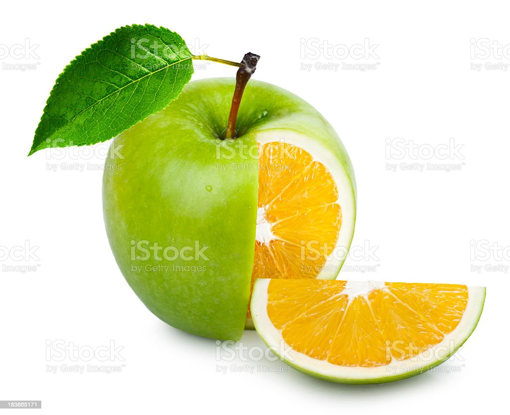Manipulated photo of a green apple with an orange inside stock photo