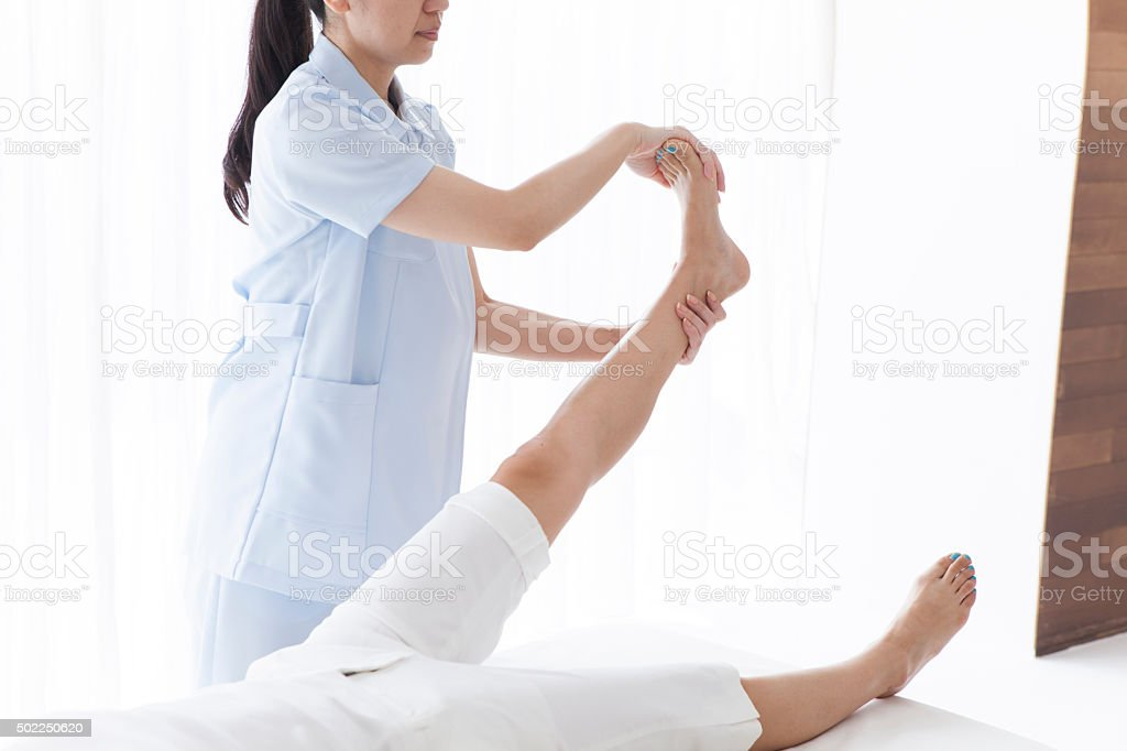 Manipulative teacher to extend the ankle stock photo