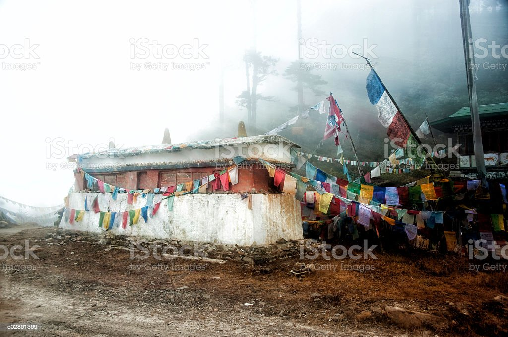 Mani-Wall with prayer flags on Thrumsingla, Bhutan. stock photo