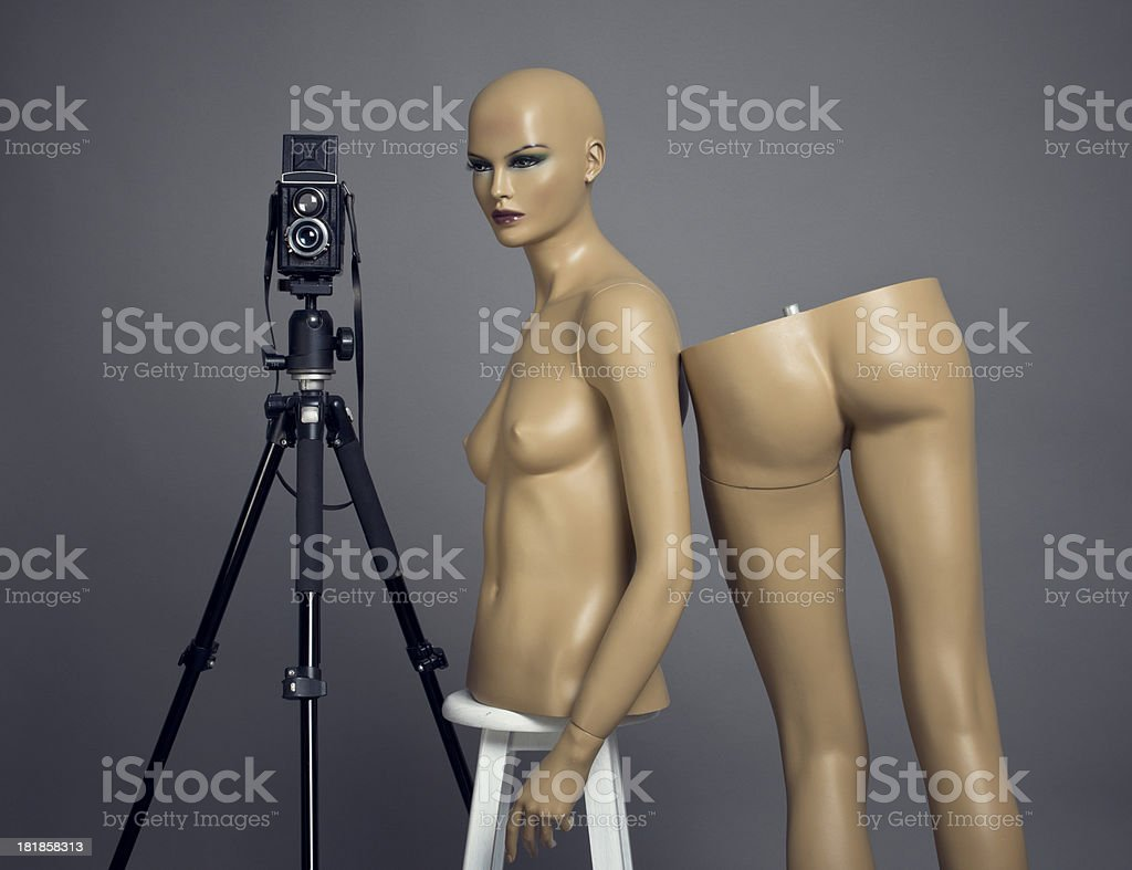 Mannequin and old fashionad camera royalty-free stock photo