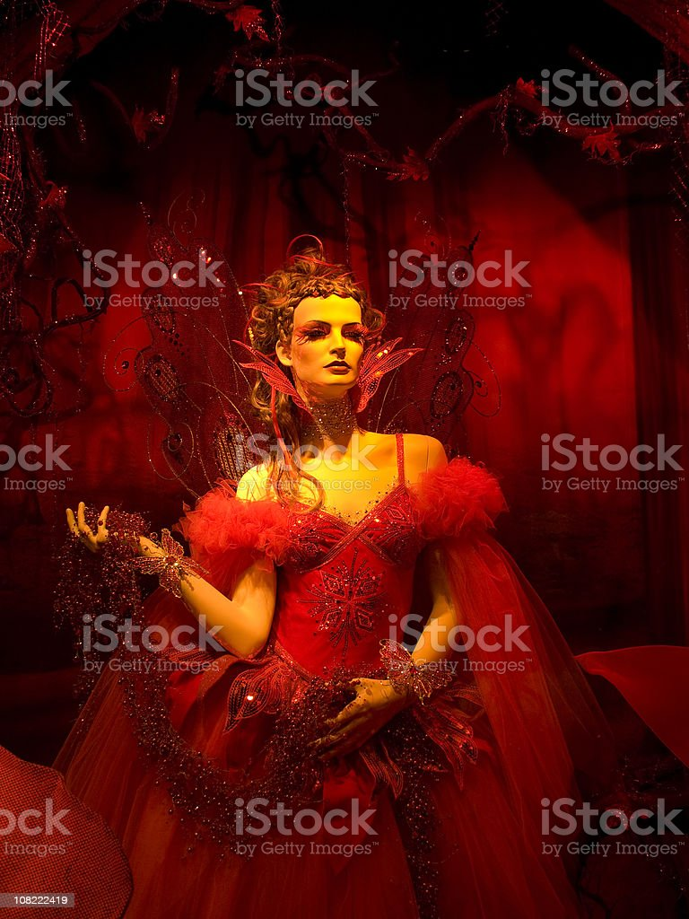 Mannequin Dressed as Red Winter Fairy stock photo