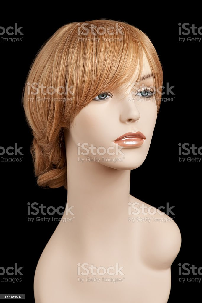 Mannequin head with auburn wig stock photo