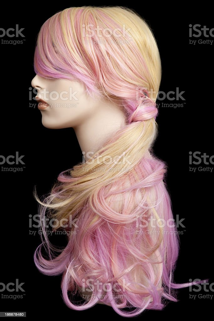 Mannequin head with blond and pink wig stock photo