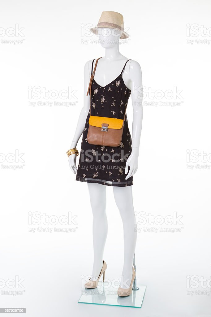 Mannequin in a dress with accessories. stock photo