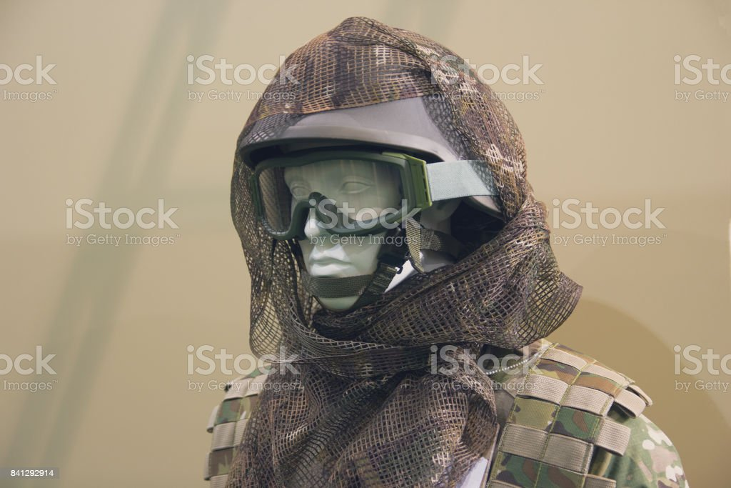 Mannequin in an army helmet and tactical sunglasses stock photo