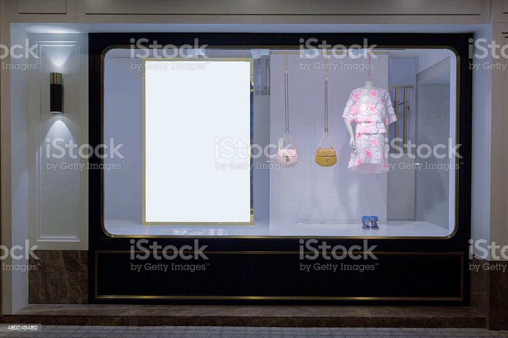 mannequin in fashion shop display window stock photo