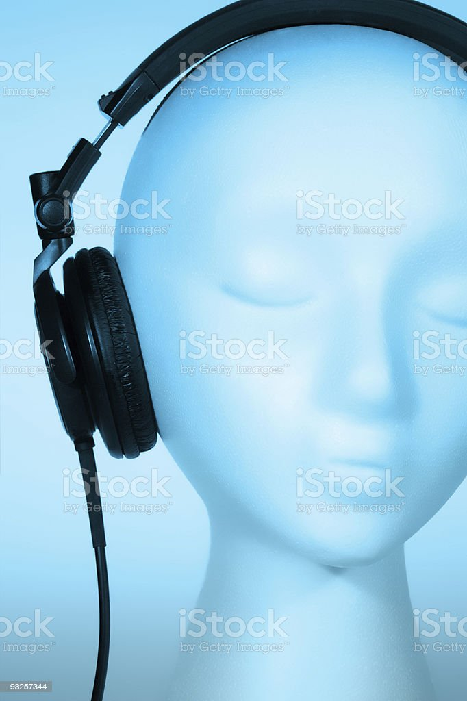 Mannequin listening to Music Close-up royalty-free stock photo
