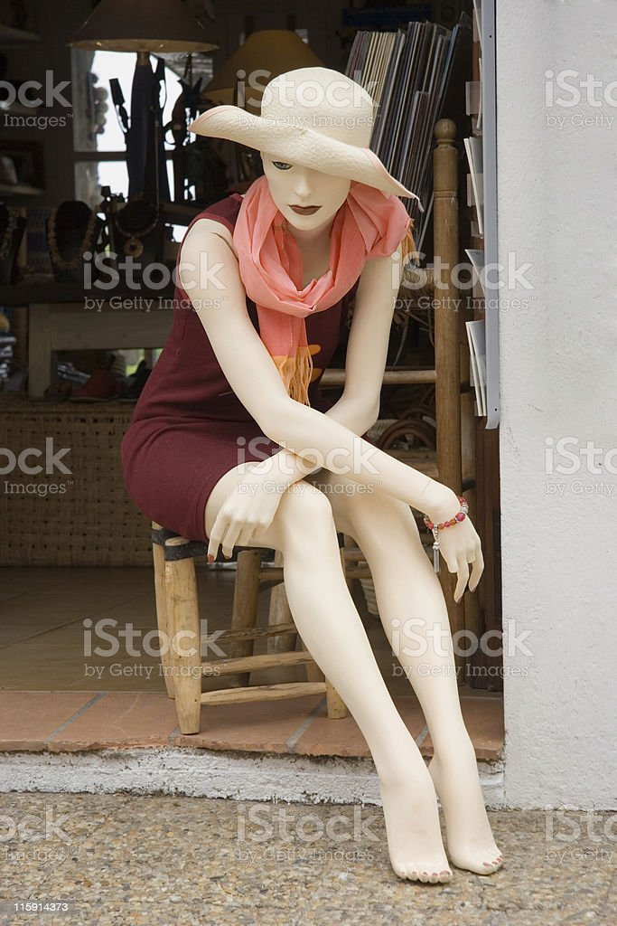 mannequin on a chair stock photo