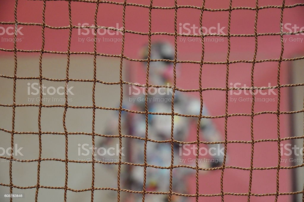 Mannequin trapped in a net. stock photo