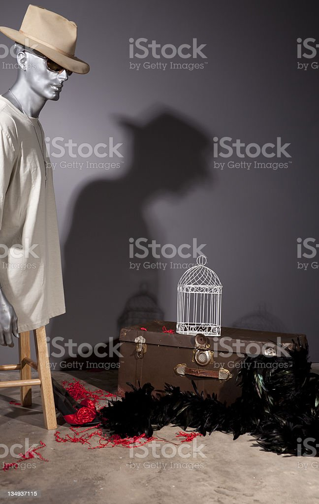 Mannequin, trunk and birdcage in attic. royalty-free stock photo