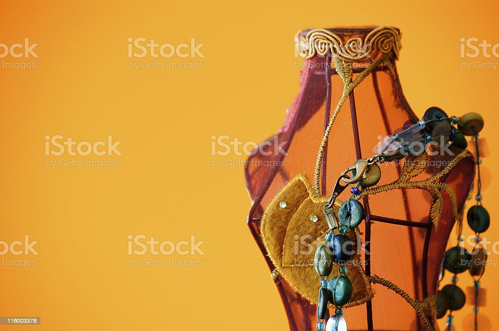 Mannequin with blue necklace hanging stock photo