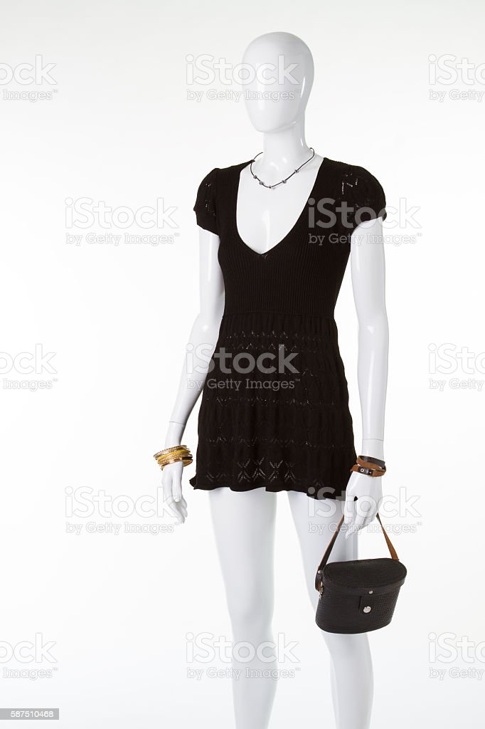Mannequin with dress and necklace. stock photo