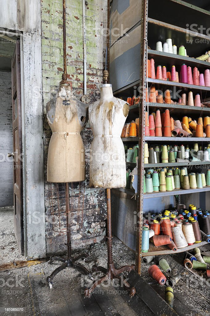 Mannequins and Colorful Thread Bobbins, Abandoned American Sewing Factory royalty-free stock photo