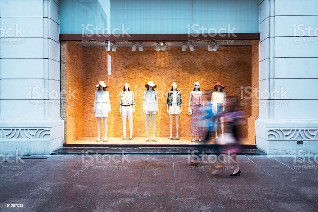 mannequins at shopfront stock photo