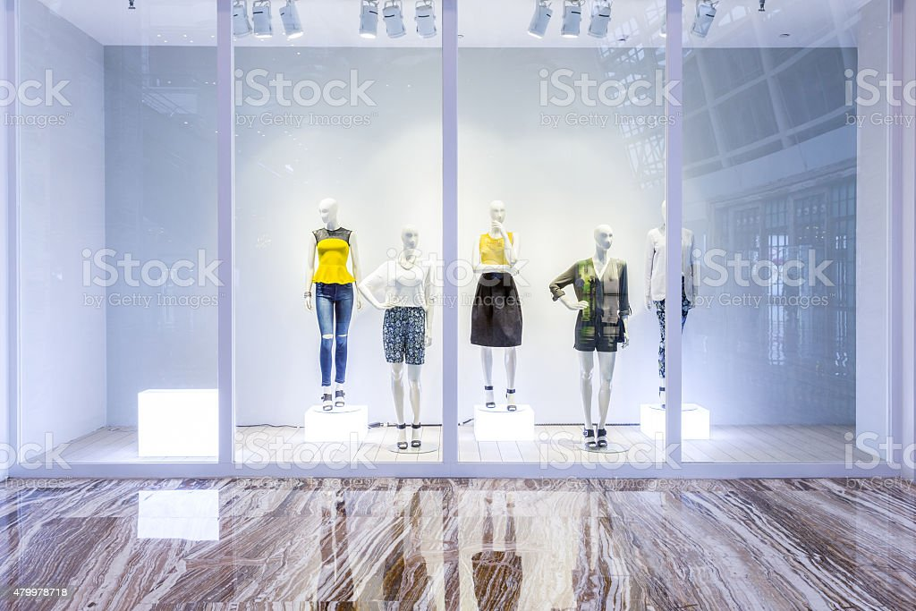 mannequins in fashion shop display window stock photo