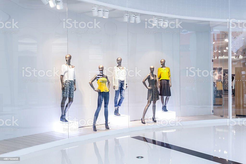 Mannequins in fashion shopfront stock photo