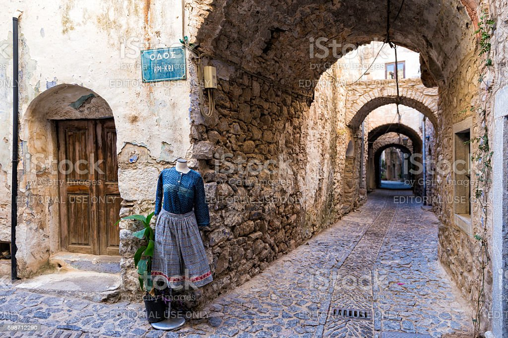Mannequins with women dress on the narrow streets of Mesta stock photo
