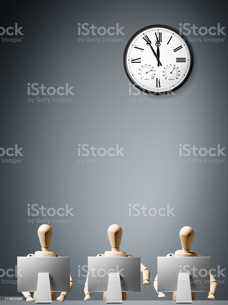 3 mannequins working hard at computers with clock royalty-free stock photo