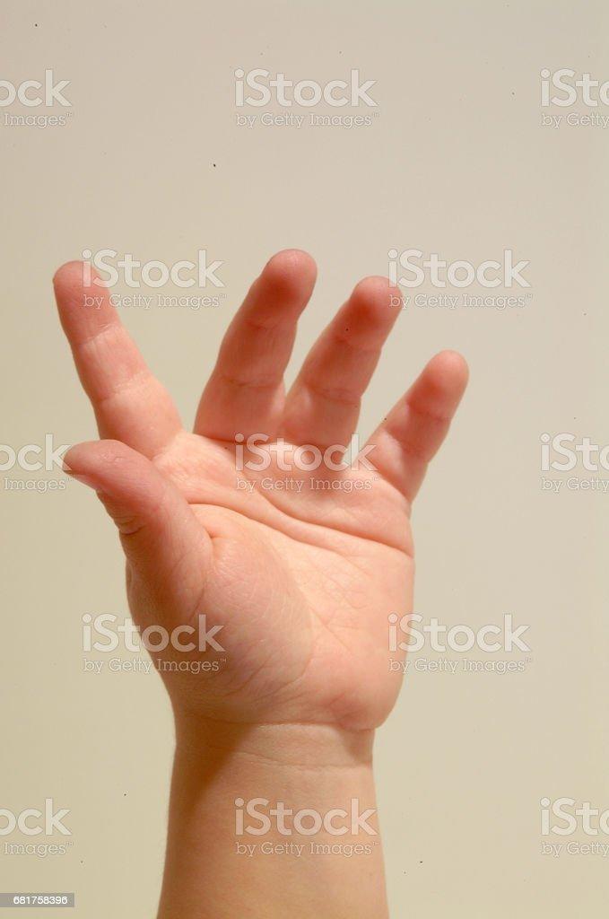 mano di bambino stock photo