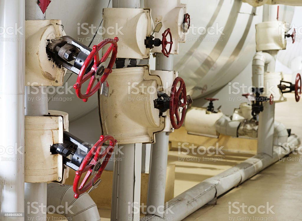 manometer, pipes and faucet valves of heating system stock photo