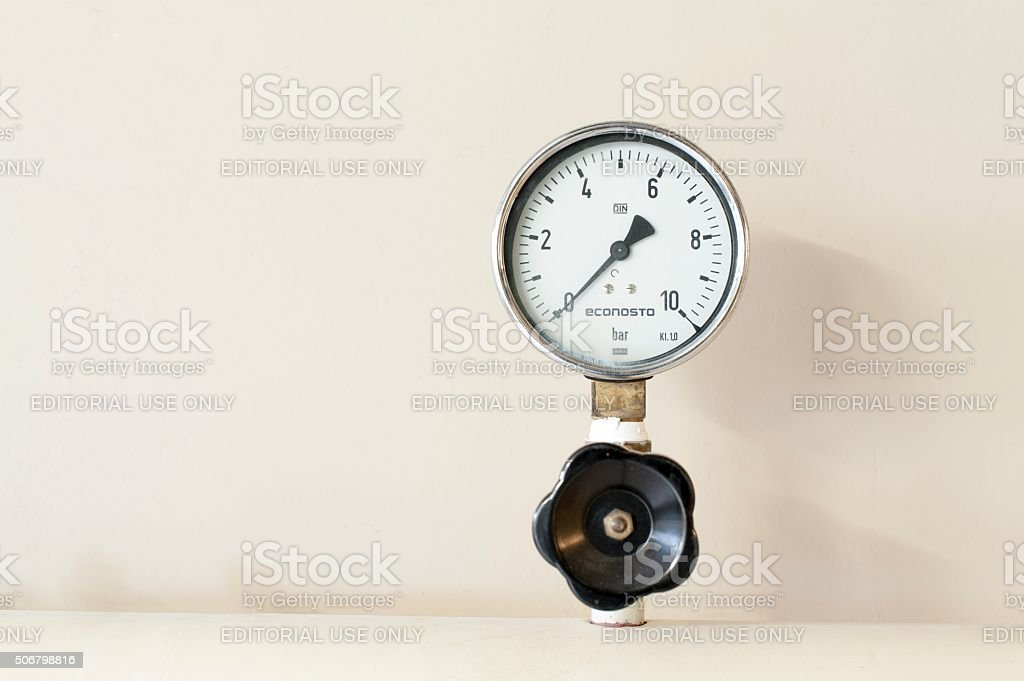 Manometer with valve for a central heating system. stock photo