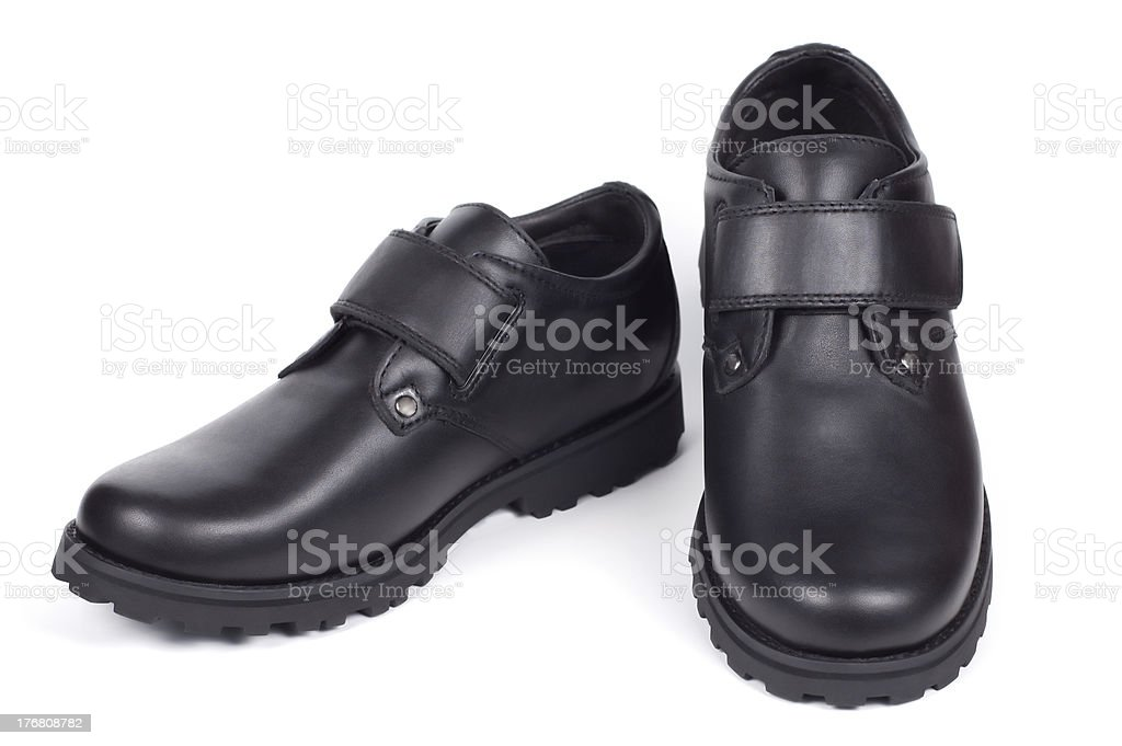 Man's boots isolated on a white background shadow below. royalty-free stock photo