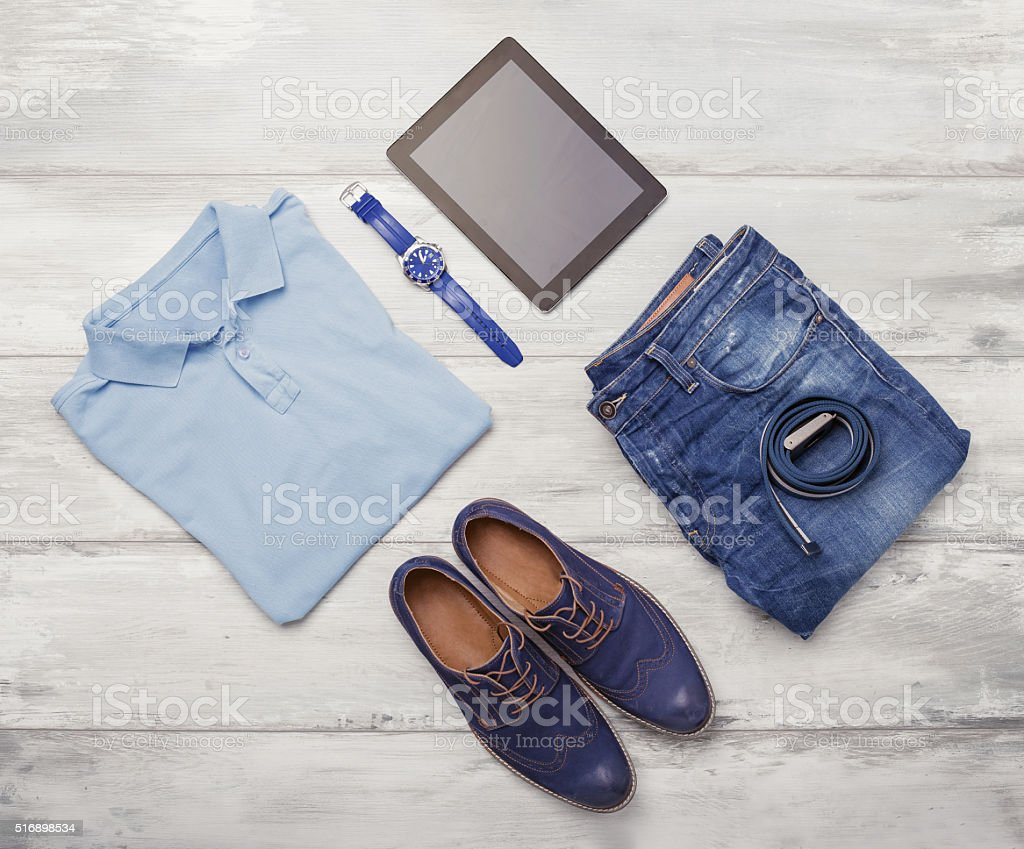 Man's clothing, watch and tablet royalty-free stock photo