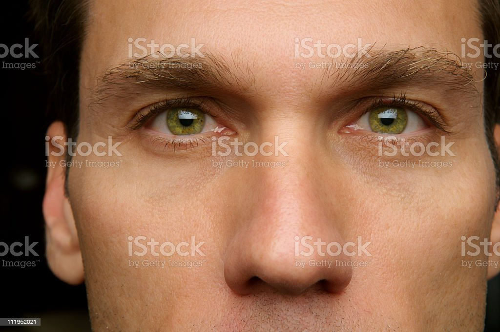 Man's Face Green Eyes Close Up royalty-free stock photo