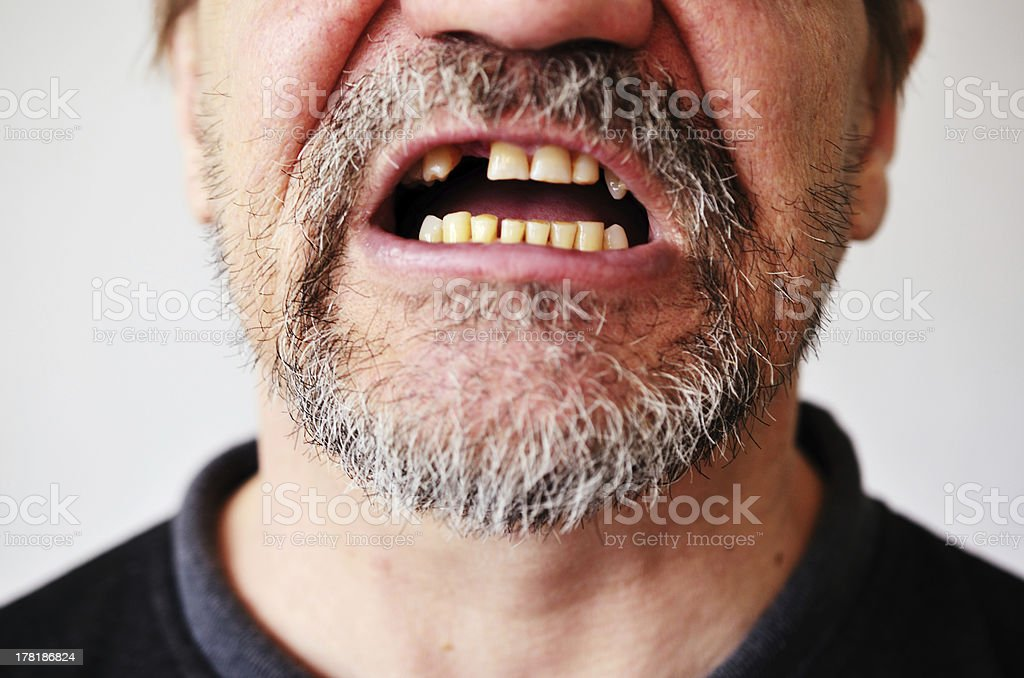 man's face with an open toothless mouth stock photo