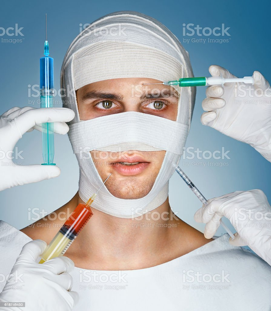 Man's face wrapped in bandages stock photo