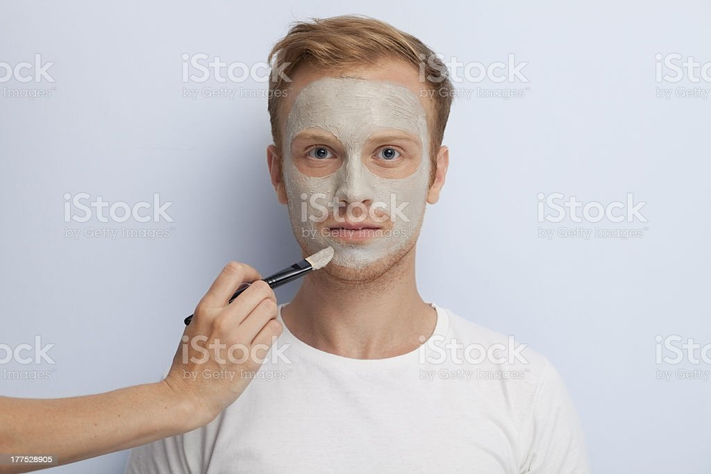 Man's facial cosmetic treatment. royalty-free stock photo