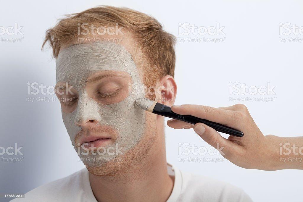 Man's facial cosmetic treatment. royalty-free stock photo