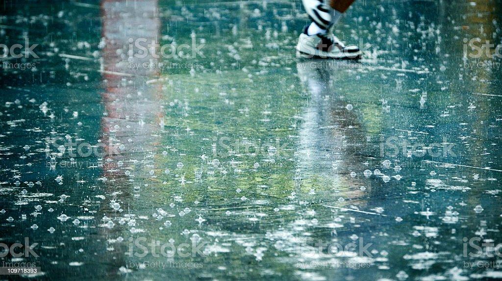 Man's Feet in the Rain stock photo