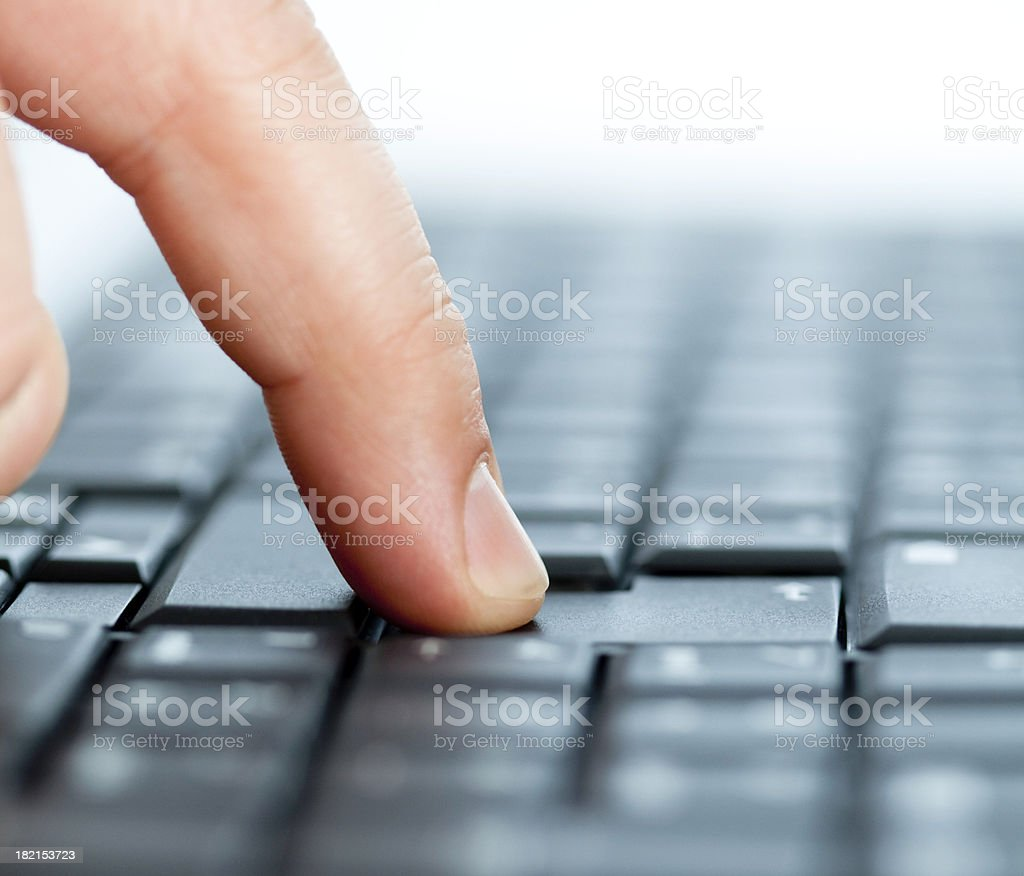 Man`s finger pushes the return button on black keyboard royalty-free stock photo
