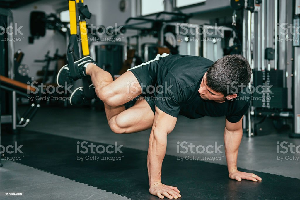 Man's fitness - TRX exercising stock photo