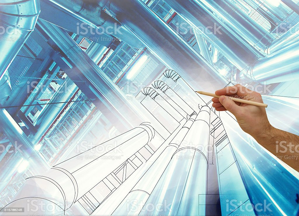 man's hand draws a design of factory combined with photo stock photo