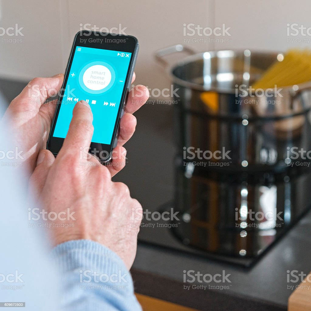 Man Hand Holding Mobile Phone Smart Control Home Cooker Kitchen With Control  Home With Phone