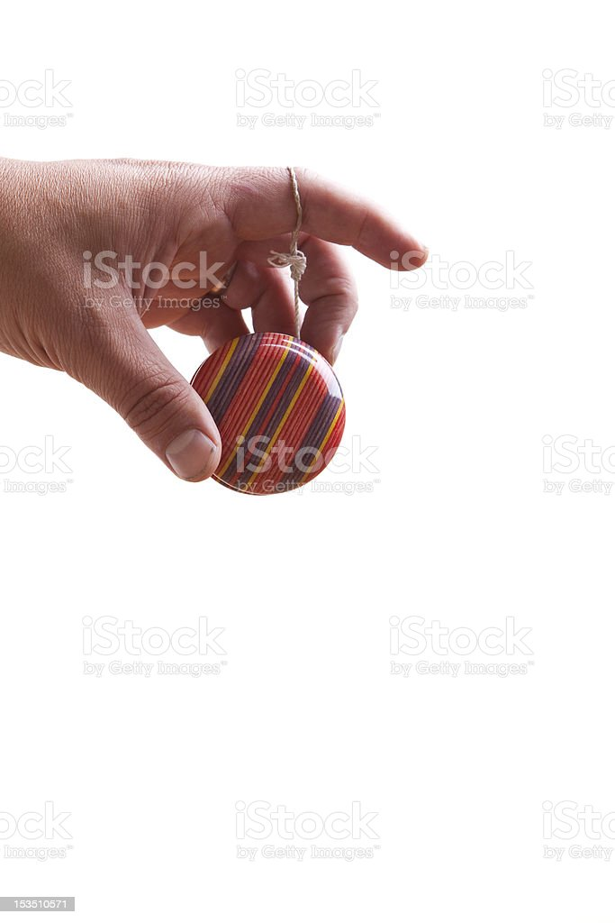 Man's hand holding multi-colored yoyo stock photo
