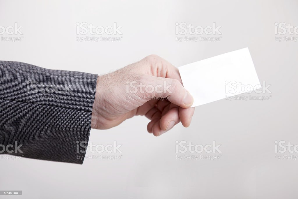 Mans hand holding out a business card stock photo