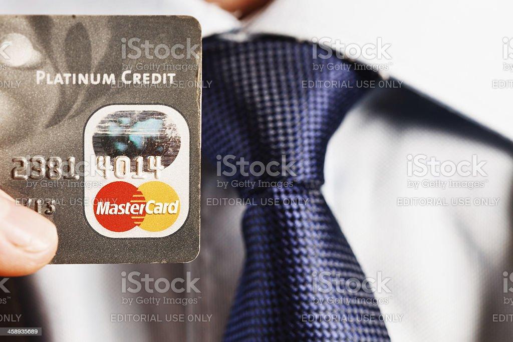 Man's hand holding Platinum Mastercard royalty-free stock photo